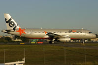 VH-JQG @ YSSY - early arrival....taxiing to terminal. - by Bill Mallinson