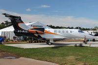 PT-PYV @ OSH - Embraer Phenom 300, c/n: 5050043 displayed at 2011 Oshkosh