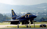 154975 @ RDG - A-4F Skyhawk Blue Angels number 5 on the flight-line at the 1976 Reading Airshow. - by Peter Nicholson