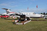 N265NX @ OSH - Pilatus Aircraft Ltd PC-12/47E, c/n: 1265 - static display at 2011 Oshkosh