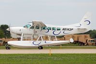 N6143P @ OSH - Cessna 208, c/n: 20800514 arriving at 2011 Oshkosh