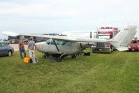 N19EZ @ OSH - 1970 Cessna T337E, c/n: 33701315 - setting up for Static Display at 2011 Oshkosh