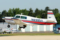 N6985V @ OSH - 1976 Mooney M20F, c/n: 22-1347 arriving at 2011 Oshkosh - by Terry Fletcher
