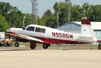 N9586M @ OSH - 1966 Mooney M20F, c/n: 670163 landing at 2011 Oshkosh