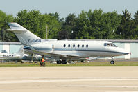 C-GMGB @ OSH - Raytheon Aircraft Company HAWKER 850XP, c/n: 258814 at 2011 Oshkosh