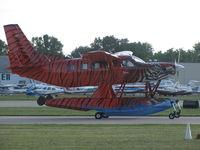 N31JA @ KOSH - Tiger stripped Quest on floats EAA 2011 - by steveowen