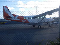 ZK-TZR @ NZWN - On apron at Wellington with its two sister aircraft close by. - by magnaman
