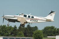 N3191A @ OSH - 1999 Raytheon Aircraft Company A36, c/n: E-3291 at 2011 Oshkosh