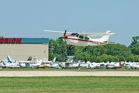 N4616C @ OSH - Cessna T210N, c/n: 21063576 at a crowded 2011 Oshkosh