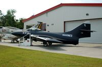 127487 @ NKT - Grumman F9F-6P Cougar on display at the Havelock Tourist & Event Center, Havelock, NC - by scotch-canadian