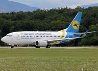 UR-GAK @ LSGG - Lining up rwy 23 for departure... - by Shunn311