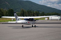 LN-LTH @ ENNO - Cessna 182E Skylane taxying on the platform of Notodden airfield, Norway. Note the artwork on its tail. - by Henk van Capelle