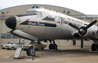 44-9030 @ DOV - 1944 Douglas C-54M Skymaster and Ford Falcons at the Air Mobility Command Museum, Dover AFB, DE - by scotch-canadian