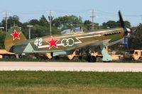 N1157H @ KOSH - Departing Airventure 2011. - by Bob Simmermon