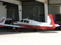 N1021U @ CCB - Parked in the Foothill Sales & service area, cowling off - by Helicopterfriend