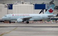 C-GARG @ KLAX - Air Canada A319 taxiing to Terminal 2 - by cx880jon