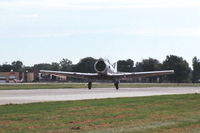 N332CA @ KDPA - Beginning take-off roll on runway 27 - by Glenn E. Chatfield