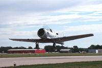 N332CA @ KDPA - Take-off on runway 27 - by Glenn E. Chatfield