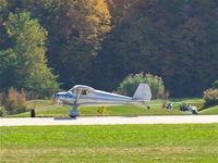 N1480B @ KSUS - Accelerating for takeoff past the golfers on runway 8R (KSUS) - by John Heilmann