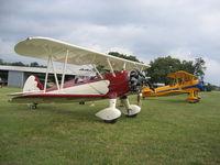 N77ED @ 2TE2 - Stearman N77ED with N621SR at Flying Oaks Tx. Memorial Day - by E.Oltheten