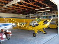 N62065 @ SZP - 1944 Piper J3C-65 CUB, Continental A&C65 65 Hp, in hangar - by Doug Robertson