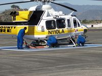 N110LA @ POC - After re-fueling, Crew assembles the Kawak Industries auxiliary hydraulic power system  snorkel - by Helicopterfriend
