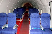 G-APSA @ EGBE - Seating layout in a DC-6A At Airbase Museum at Coventry Airport