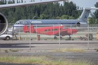 N99800 @ OPF - Beech H18 behind a couple of fences