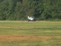 N39829 @ OH36 - Departing RWY 3 during the EAA fly-in at Zanesville, Ohio - by Bob Simmermon