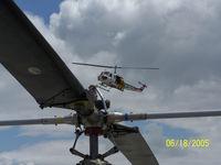 N495DF @ KSQL - Flight demo at the 2005 Vertical Challenge in San Carlos, CA.