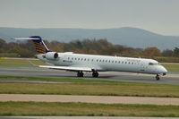 D-ACNA @ EGCC - Eurowings Canadair CL-6002D24 Regional Jet CRJ900ER taxiing Manchester Airport. - by David Burrell