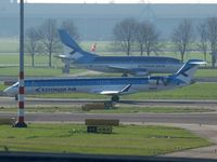 ES-ABC @ EHAM - The ES-ABC is ready for take off on runway 24 and the ES-ACB is taxi to this runway. - by Willem Goebel