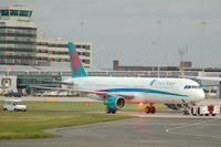 G-OOPE @ EGCC - First Choice Airbus A321-211 under tow Manchester Airport. - by David Burrell