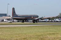 N381AA @ OPF - DC-7 painted in American colors