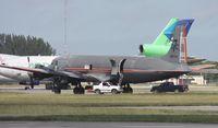 N381AA @ OPF - DC-7 in American colors