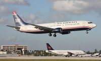 N404US @ MIA - US Airways 737 landing on 12
