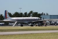 N836D @ OPF - Eastern DC-7 - by Florida Metal