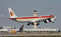 EC-JLE @ MIA - Iberia with the tower and the 16 ft shorter 747-400 in the background.