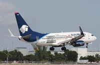 EI-DRD @ MIA - Aeromexico Visa ad - El Dorado location