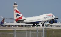 G-CIVD @ MIA - British 747 with tower and Cargo City in the background