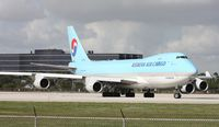 HL7601 @ MIA - After about 3 planes landed, the Korean 747 now cleared for take off on 9