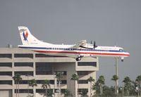 N288AM @ MIA - Eagle ATR-72 landing Runway 8L