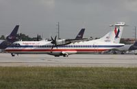 N417AT @ MIA - Eagle ATR-72 getting ready to depart on 8R by photo holes