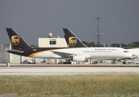 N466UP @ MIA - UPS 757 across from the photo holes