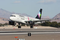 XA-VOP @ LAS - Volaris Fernando XA-VOP (FLT VOI960) with the breast cancer awareness scheme arriving to RWY 25L from Don Miguel Hidalgo y Costilla Int'l (MMGL/GDL) - Guadalajara, Mexico. - by Dean Heald