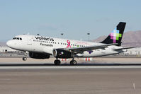 XA-VOP @ LAS - Volaris Fernando XA-VOP (FLT VOI960) with the breast cancer awareness scheme landing RWY 25L from Don Miguel Hidalgo y Costilla Int'l (MMGL/GDL) - Guadalajara, Mexico. - by Dean Heald