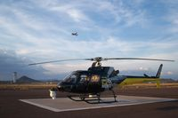 N215TV @ DVT - Resting on the west helipad - by Jarrett