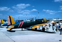 N13VV @ WRI - BT-13B named 'Vintage Vibrations' on a crowded ramp, after arrival of the Freedom Flight America, air tour -1995. N13VV is ex: N54822 & 42-90054 - by John Hevesi