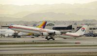 B-6051 @ KLAX - Departing LAX