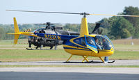 N123YW @ KDAN - This 2005 Robinson R44 11 landed then five U.S. ARMY  Loach which were nearby lined up behind on the main runway preparing for their very awesome takeoff. - by Richard T Davis